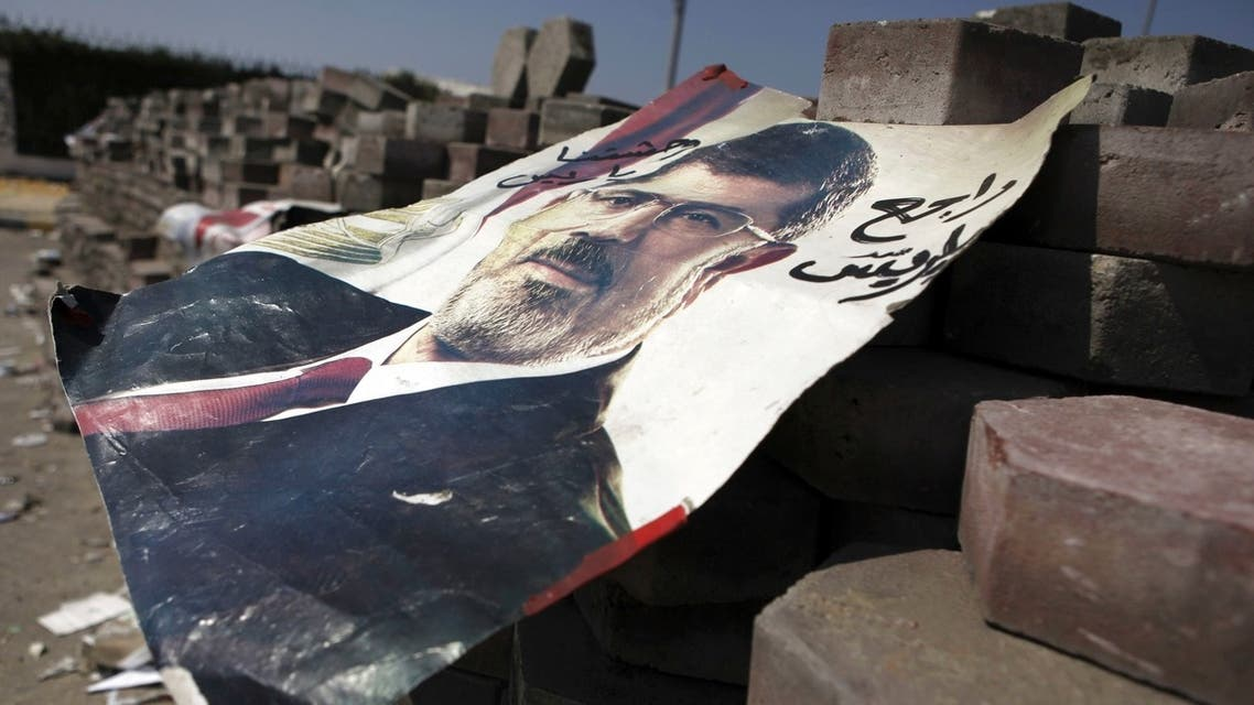 A poster of deposed Egyptian President Mohamed Mursi is seen on bricks placed throughout the camp, at the entrance to their campsite near the Tomb of the Unknown Soldier, close to Rabaa Adawiya Square