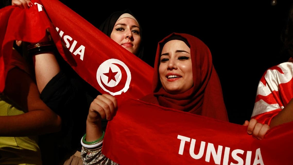 Demonstrators hold scarves during a protest to demand the ouster of the Islamist-dominated government outside the Constituent Assembly headquarters in Tunis August 3, 2013.  (Reuters)