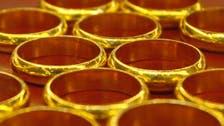 Gold falls below $1,300 as economic data hurts