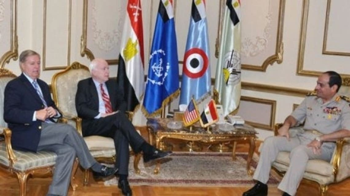 General Abdel Fattah al-Sisi (R) meeting with US senators John McCain (C) and Lindsey Graham, August 6, 2013