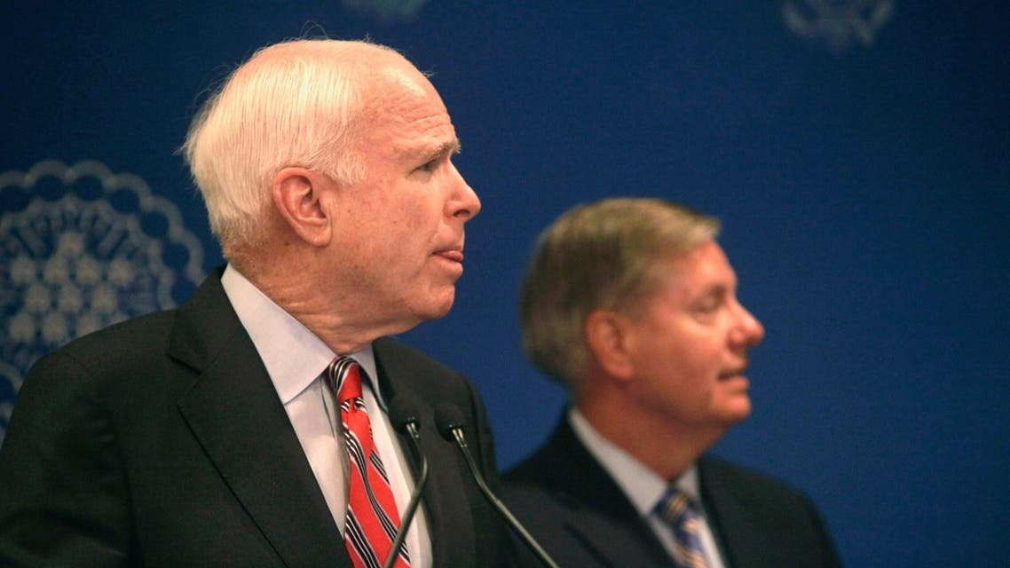 U.S. Senators John McCain and Lindsey Graham (R) talk during a news conference in Cairo, August 6, 2013. (Reuters)