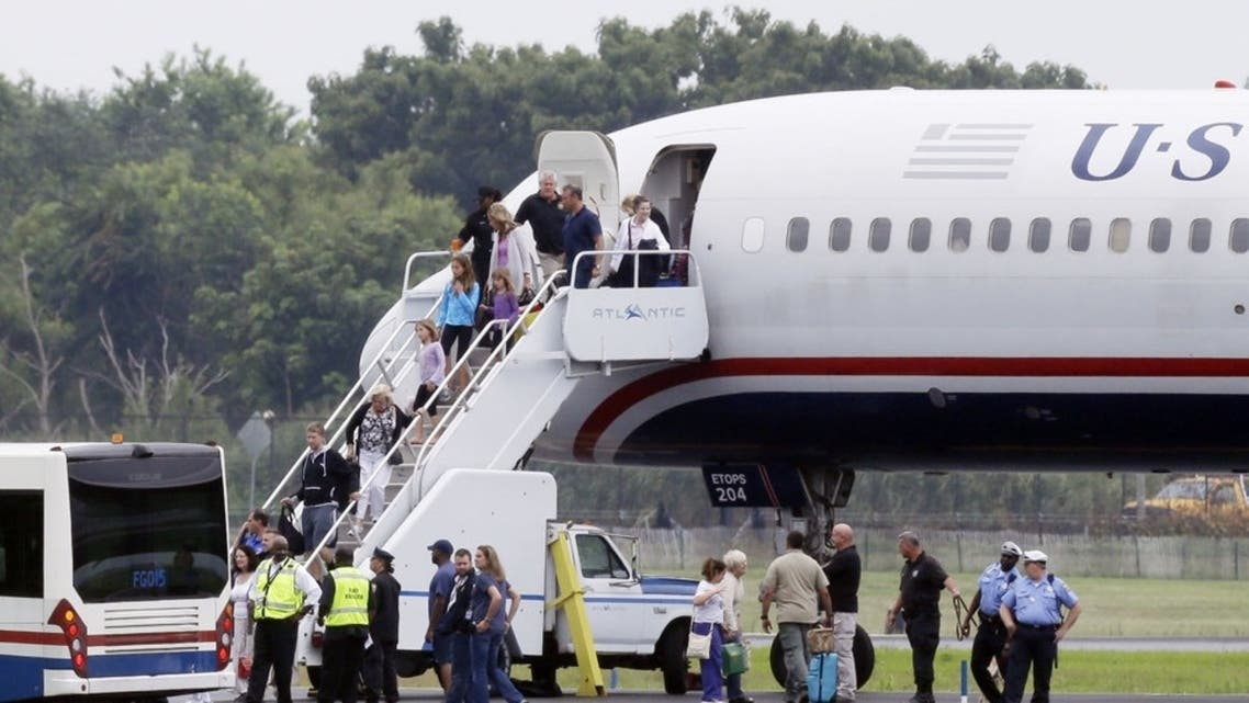 People exit a plane from Ireland that made an emergency landing because of an unspecified threat. (Courtesy Photo of AP)