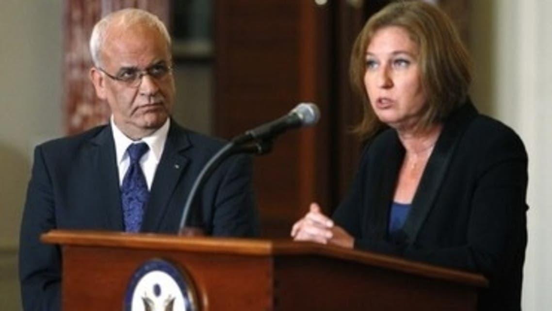 Palestinian negotiator Saeb Erekat and Israeli negotiator Tzipi Livni at a press conference, July 30. (Reuters)