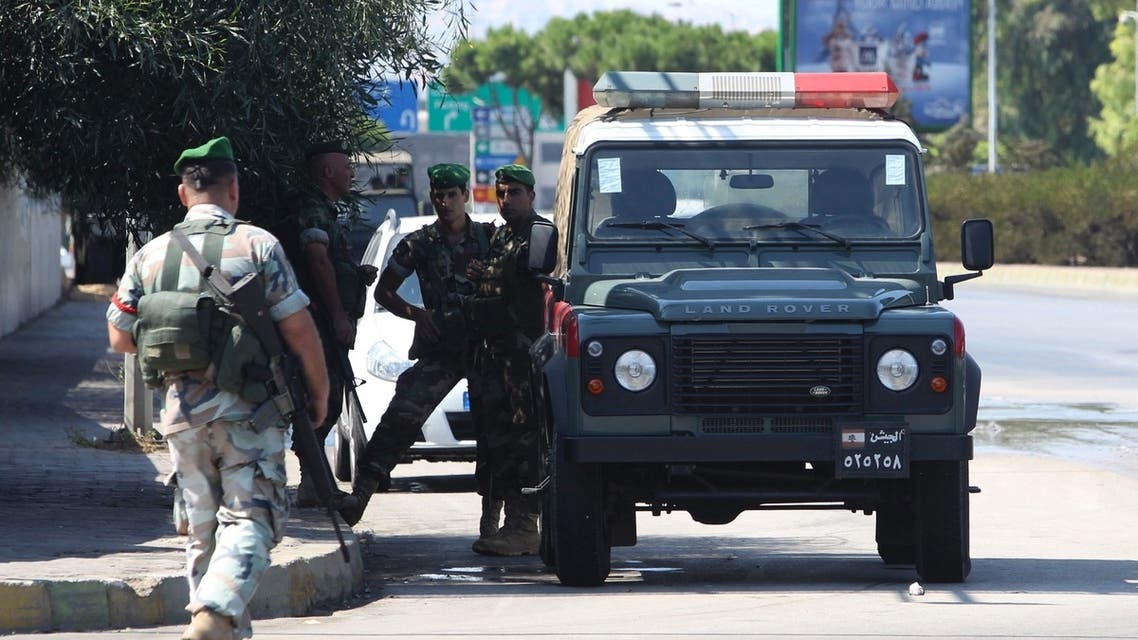 Lebanese Army soldiers patrol the road leading to Beirut international airport, following the kidnap of a Turkish airlines pilot and his colleague in Beirut, August 9, 2013. (Reuters)