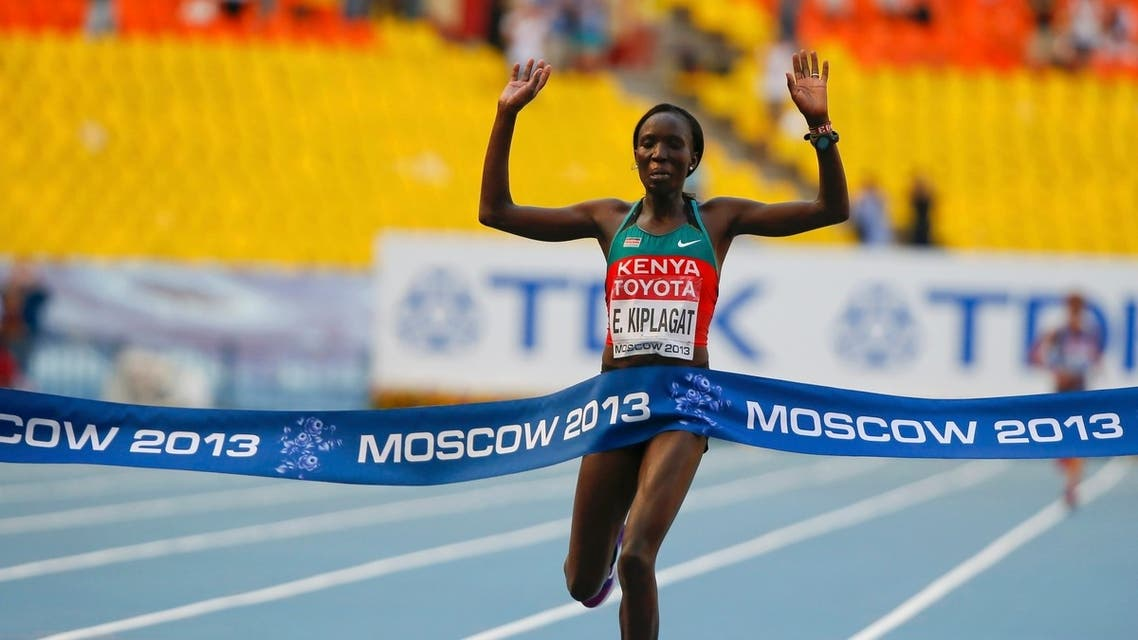 Edna Ngeringwony Kiplagat of Kenya crosses the finish line to win the women's marathon during the IAAF World Athletics Championships in Moscow, August 10, 2013.