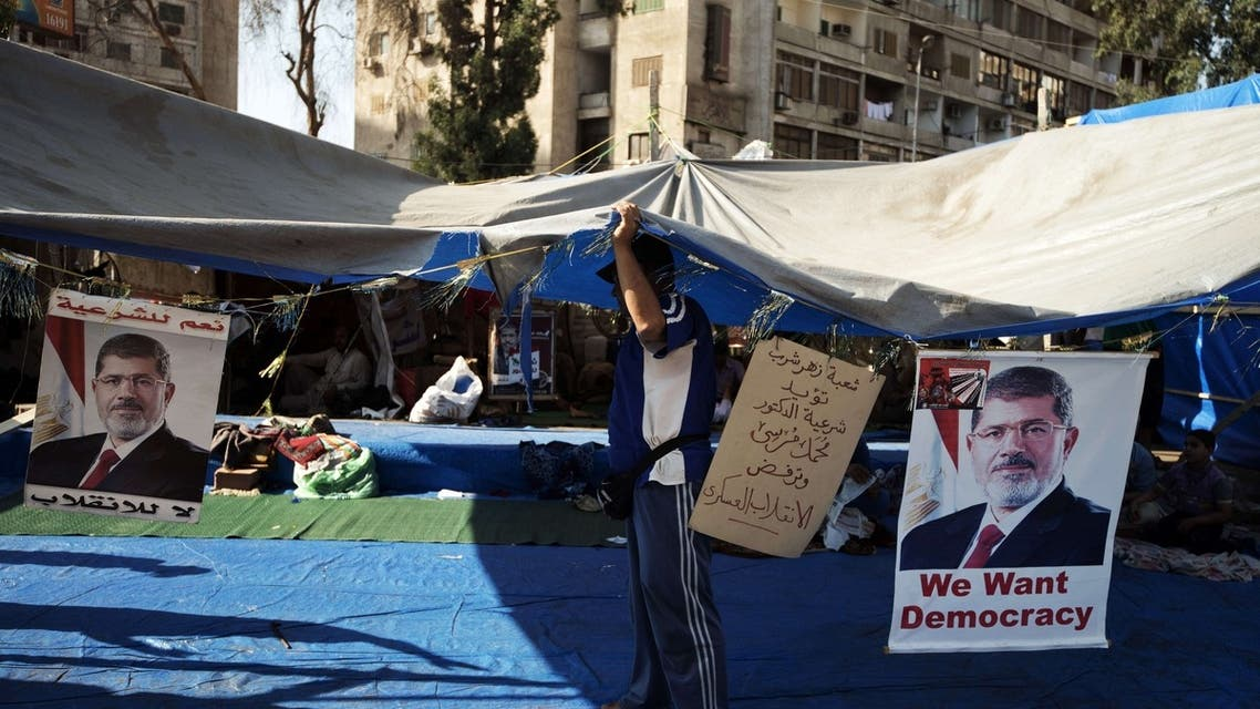 An Egyptian man fixes his tent as members of the Muslim brotherhood and supporters of ousted Egyptian President Mohammed Mursi attend a sit-in outside the Rabaa al-Adawiya mosque on August 10, 2013 in Cairo, Egypt. (AFP)