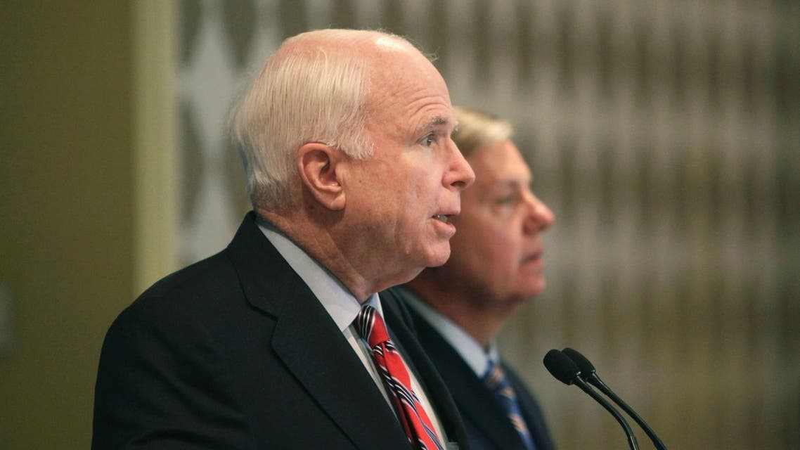 U.S. Senators John McCain and Lindsey Graham (R) address a news conference in Cairo, August 6, 2013. (Reuters)
