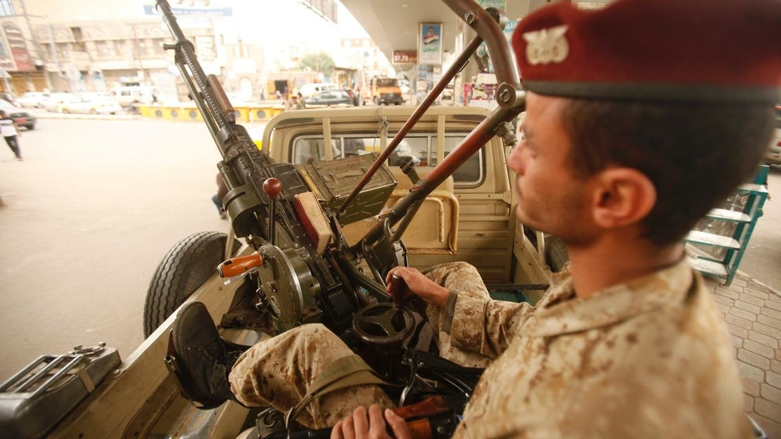An army trooper sits beside a machinegun that is mounted on a patrol vehicle at at checkpoint in Sanaa August 5, 2013.