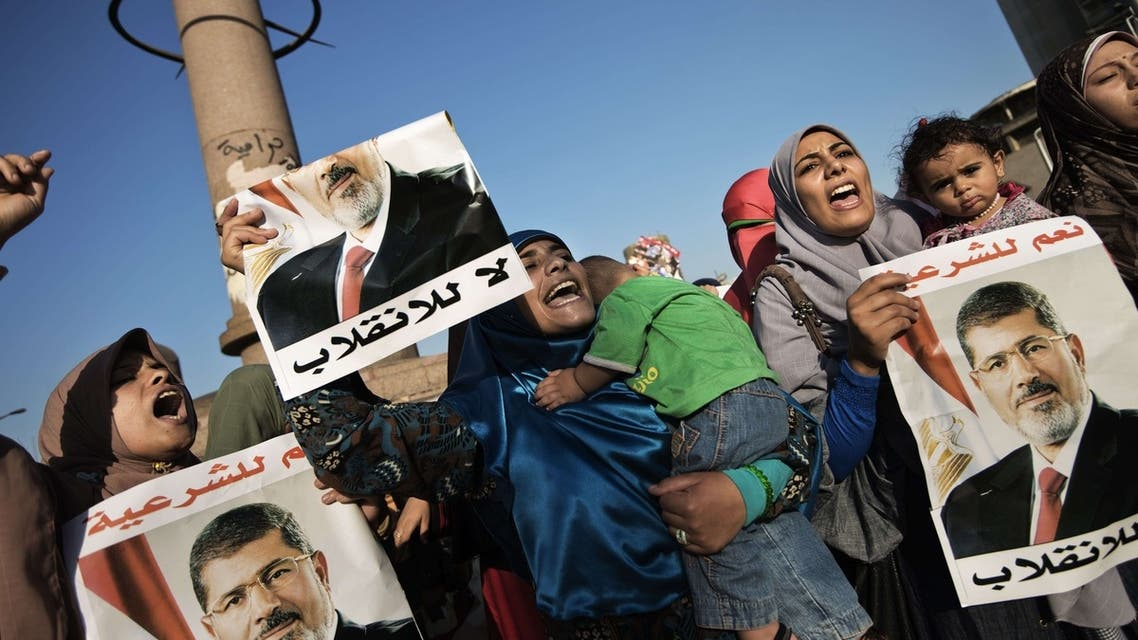 Egyptian women from the Muslim Brotherhood shout slogans and hold portraits of ousted President Mohammad Mursi as they gather in Cairo's Galaa square to attend a march in his support on August 11, 2013.
