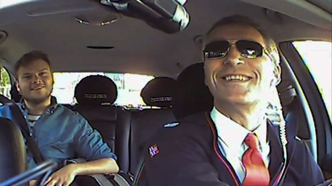 This undated low resolution video grab made available by the Norwegian Labour Party shows Norwegian Prime Minister Jens Stoltenberg (R) acting as a taxi driver in Oslo