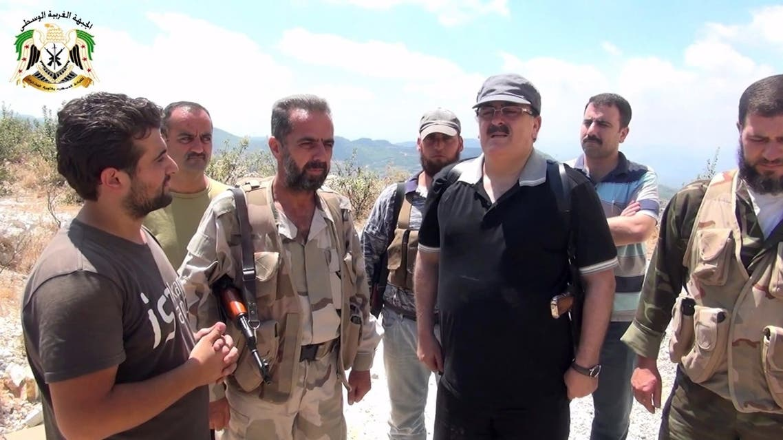 An image grab taken from a video published on the Youtube account Jableh1990 on August 11, 2013 allegedly shows Syrian rebel leader General Salim Idris (C-R) talking to rebel fighters in the outskirts of Latakia. (AFP)
