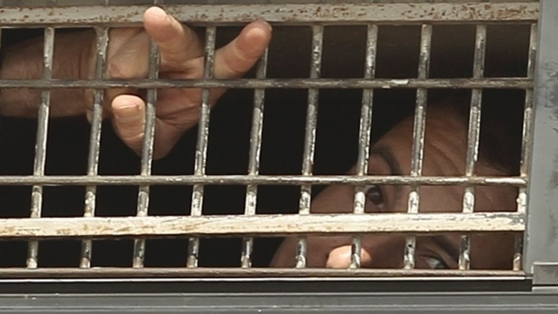 prison reuters A Palestinian prisoner gestures from the window of a bus as it leaves Nafha Prison near the southern Israeli town of Mitzpe Ramon, Oct. 16, 2011. (photo by REUTERS )