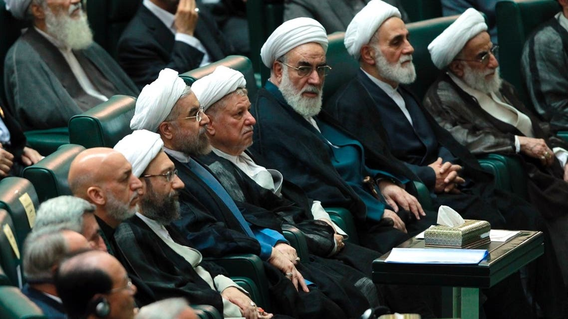 Iran's new President Hassan Rouhani (5th R) attends his swearing-in ceremony at the Iranian Parliament in Tehran in this August 4, 2013