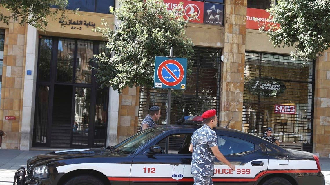 Lebanese security forces stand outside the Turkish Airlines office in downtown Beirut, August 9, 2013. (Reuters)