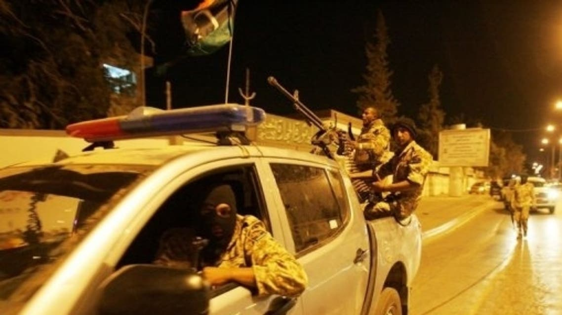 Members of the Libyan security forces drive through Benghazi in May 2013. (File photo: AFP)
