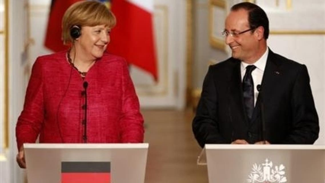France's President Francois Hollande (R) and German Chancellor Angela Merkel attend a joint news conference at the Elysee Palace in Paris, May 30, 2013. (Reuters)