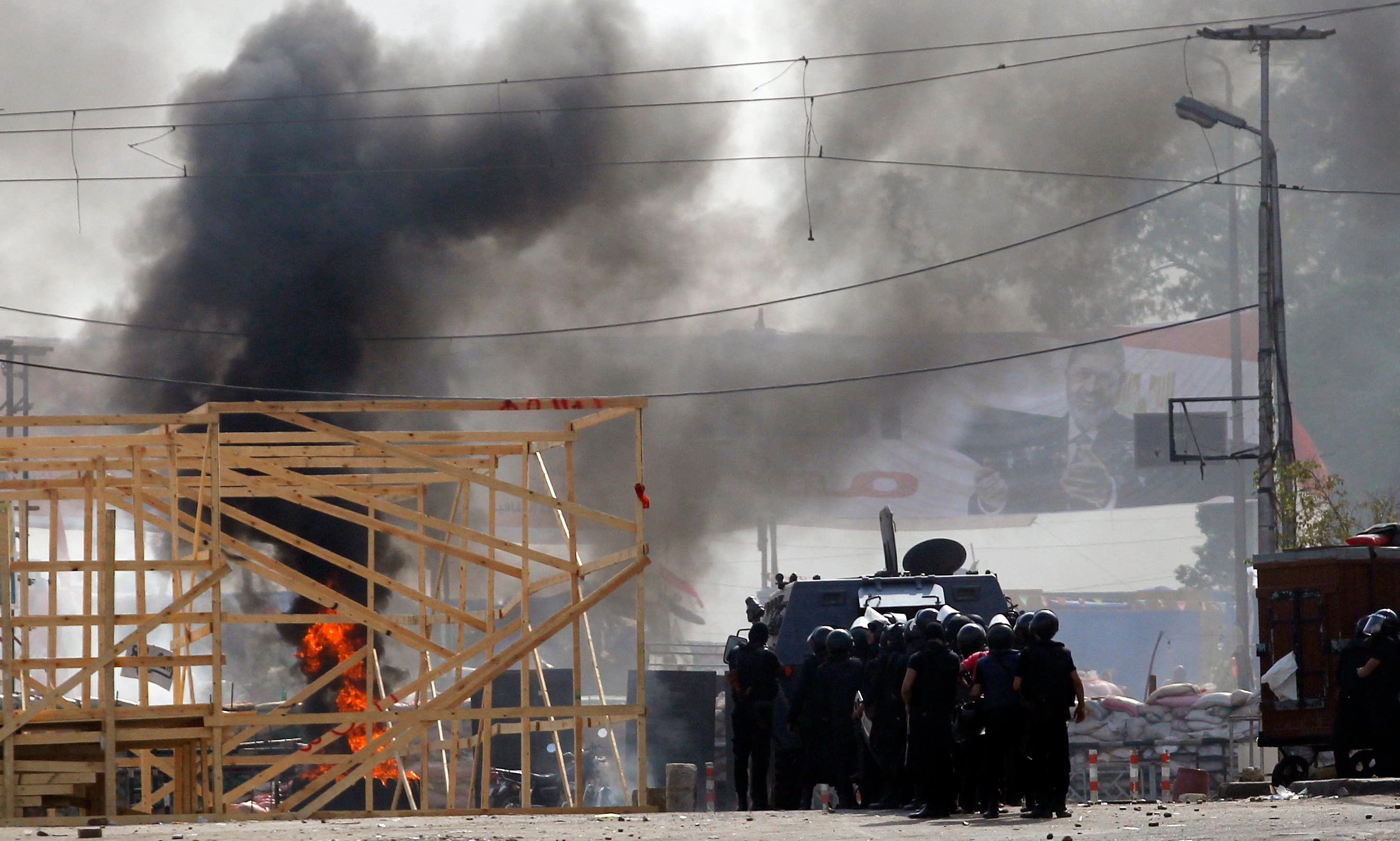 Egypt police disperse pro-Mursi camps