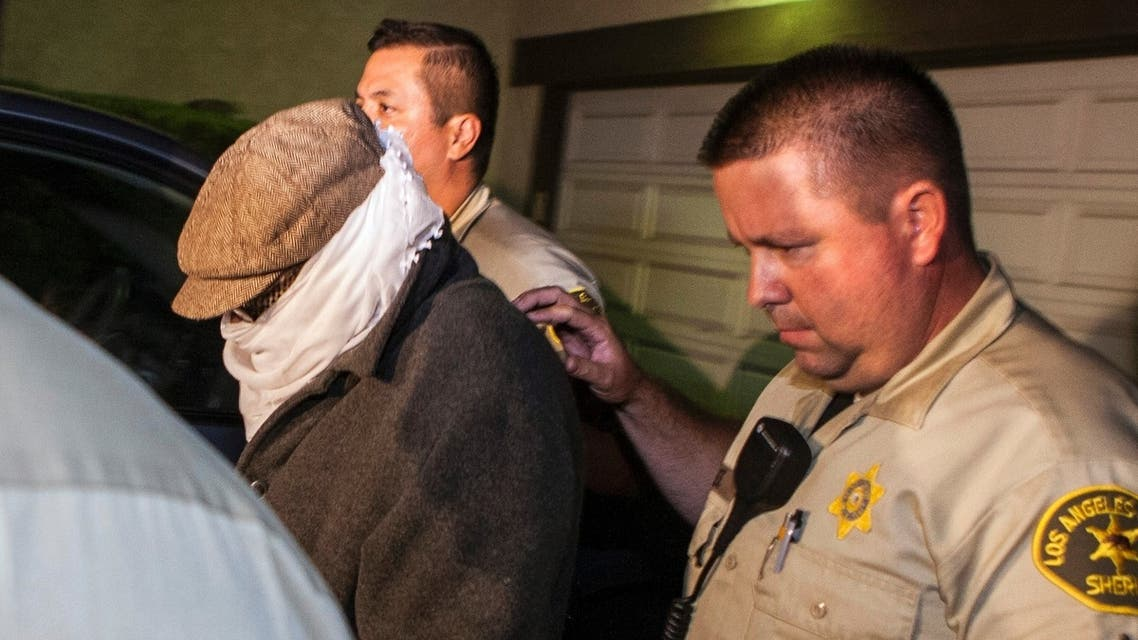 Mark Basseley Youssef, formerly known as Nakoula Basseley Nakoula, is escorted out of his home by officers in September 2012. (File photo: Reuters)