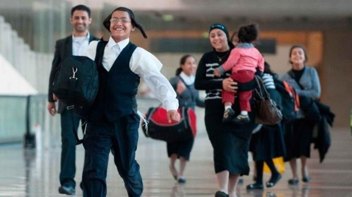 Yemeni Jews reunited with family memembers at Ben Gurion International Airport, August 14, 2013 (Photo Courtesy of Haaretz)