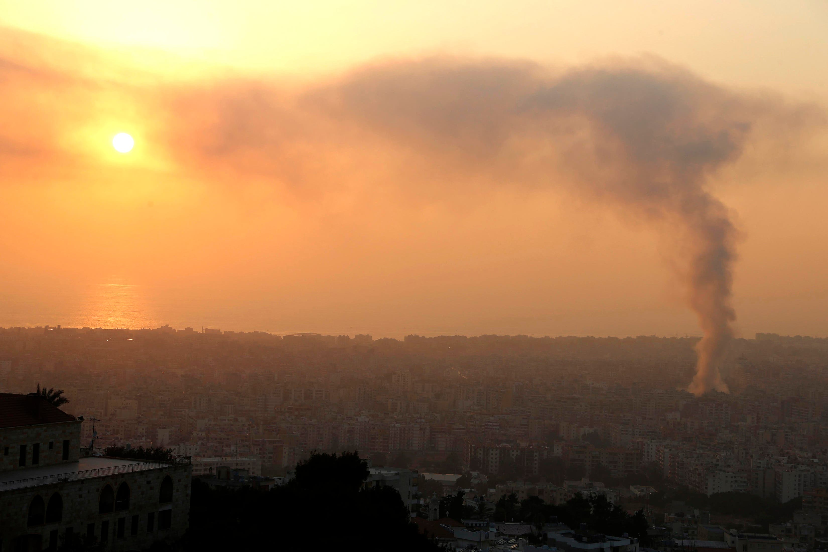 Smoke rises behind buildings from the site of an explosion in Beirut's southern suburbs, August 15, 2013. (Reuters)