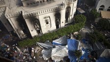 Mursi loyalists mourn their dead, as clean-up underway in protest camp