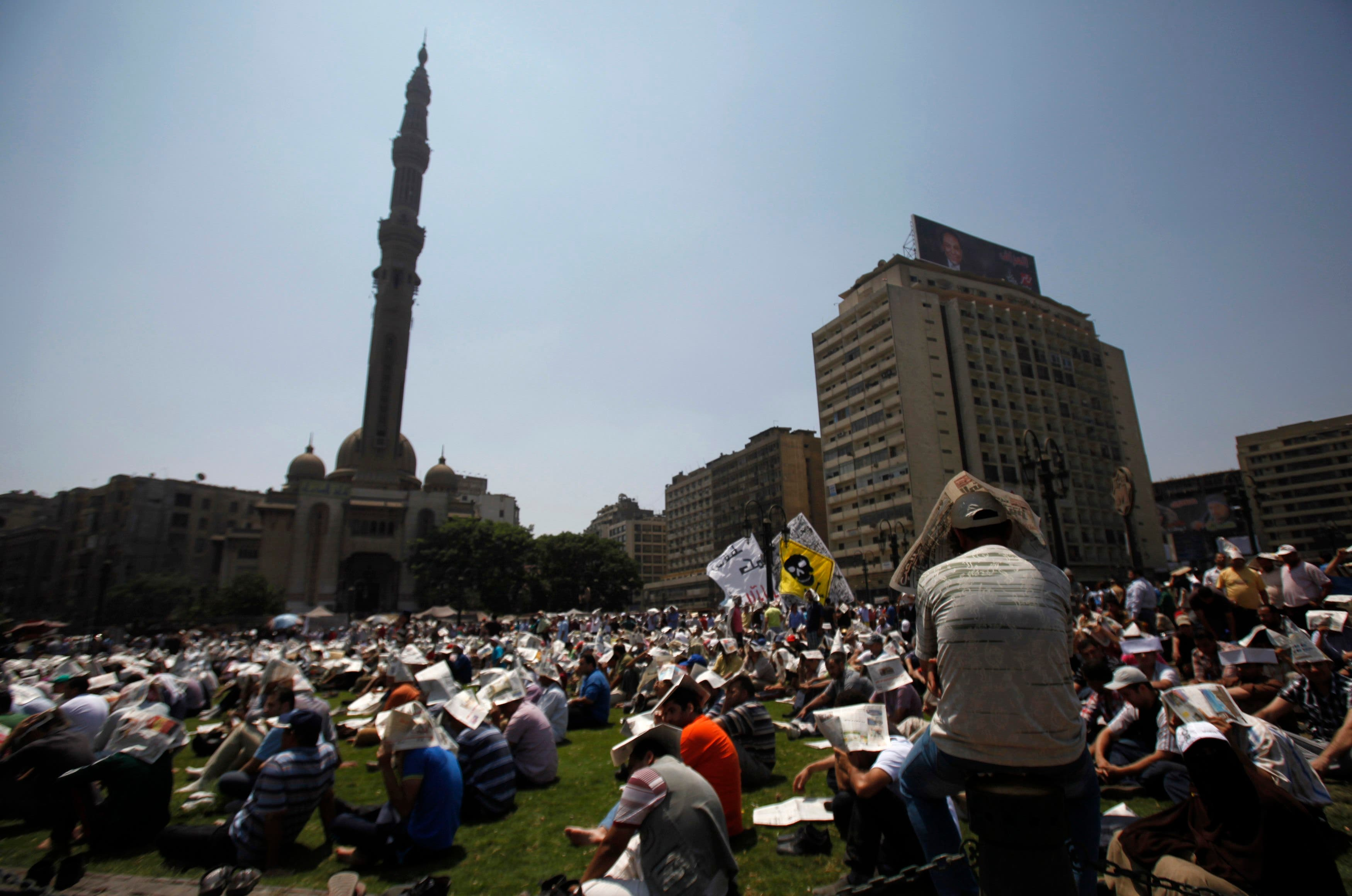 Members of the Muslim Brotherhood and supporters of ousted Egyptian President Mohamed Mursi attend Friday prayers at Ramses Square in Cairo August 16, 2013. (Reuters)