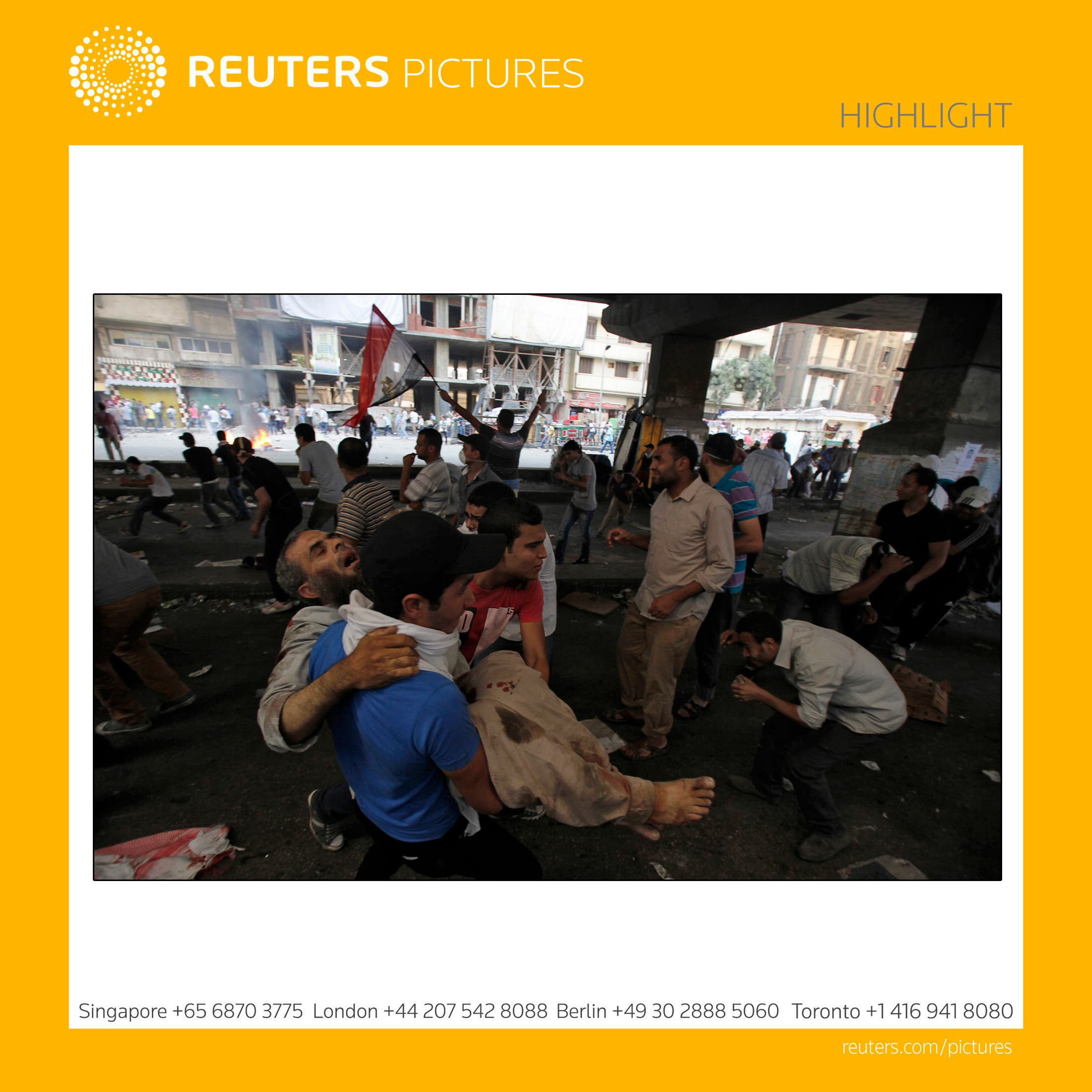 - Supporters of deposed Egyptian President Mohamed Mursi carry an injured demonstrator who was shot during clashes in front Azbkya police station at Ramses Square in Cairo on August 16, 2013. (Reuters)