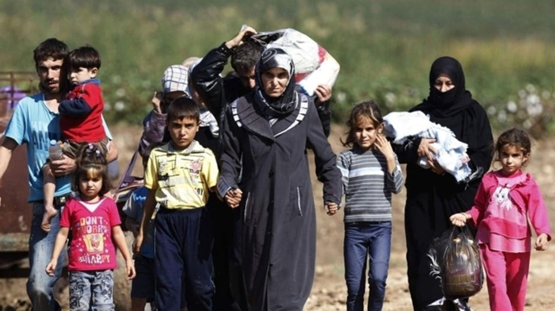 Thousands of Syrian refugees poured into the Kurdistan region of northern Iraq on Thursday. (File photo: Reuters)