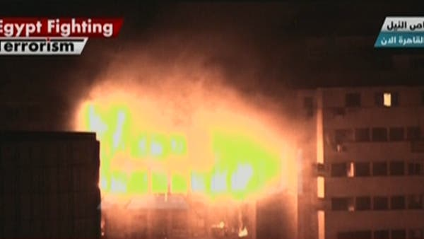 Fire consumes the Arab Contractor's building at Ramses Square in Cairo. (Al Arabiya)