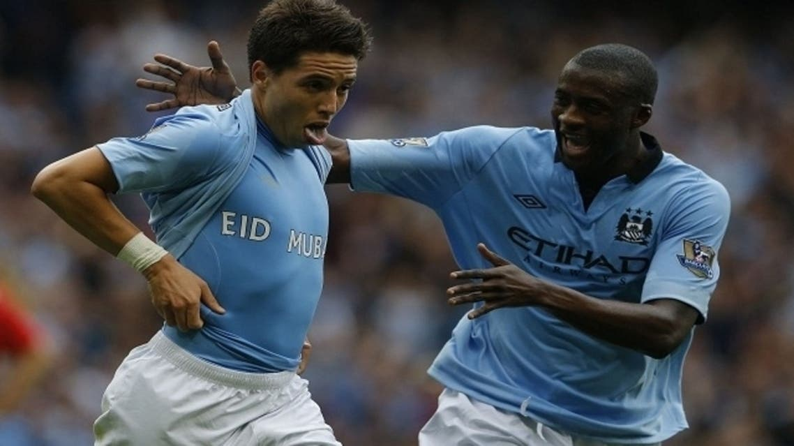 Samir Nasri (L) celebrates goal against Southampton with Yaya Toure (R). Both are devout Muslims, as Nasri is seen supporting an 'Eid Mubarak' shirt (File Photo: Reuters)