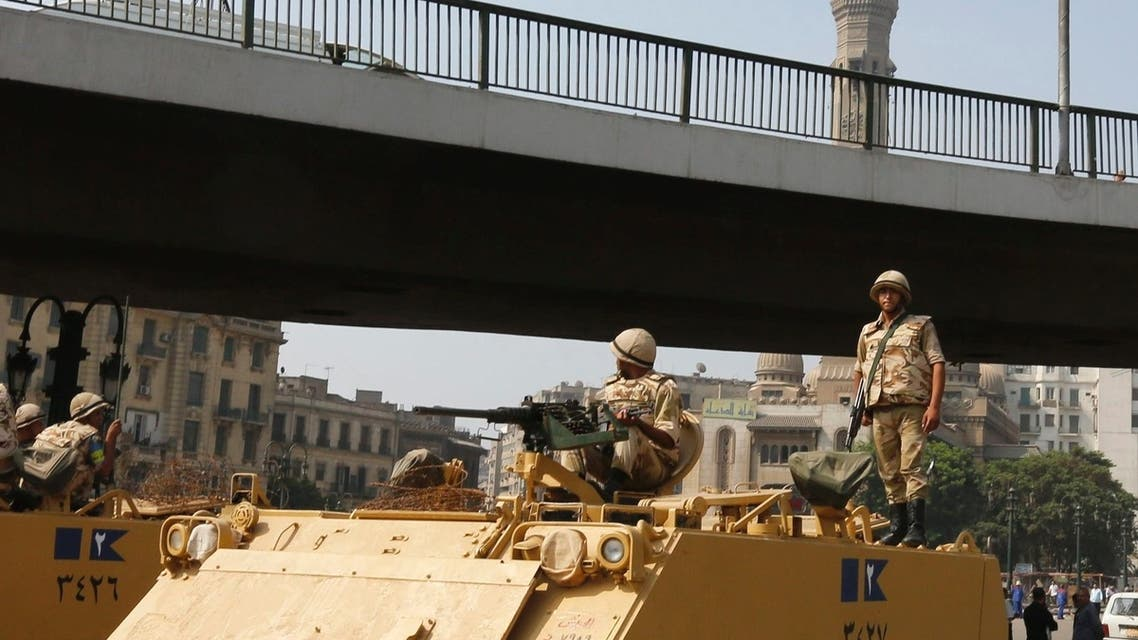 A soldier holds his weapon as he stands on an armoured personnel carrier positioned outside Ramses Square, near al-Fath mosque in Cairo August 17, 2013. (Reuters)