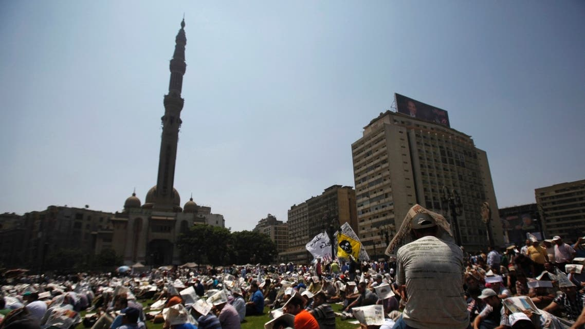 Members of the Muslim Brotherhood and supporters of ousted Egyptian President Mohamed Mursi attend Friday prayers at Ramses Square in Cairo August 16, 2013.