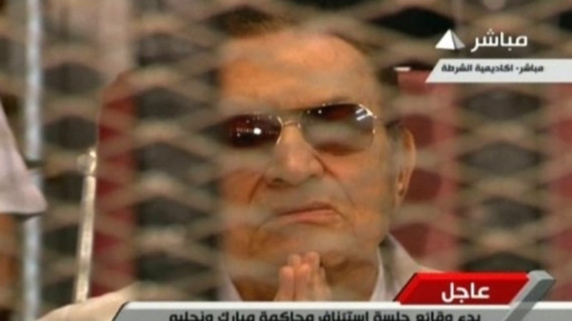 An image grab from Egyptian state TV shows Hosni Mubarak at a hearing at the police academy in Cairo on July 6, 2013 (Egyptian TV/AFP)