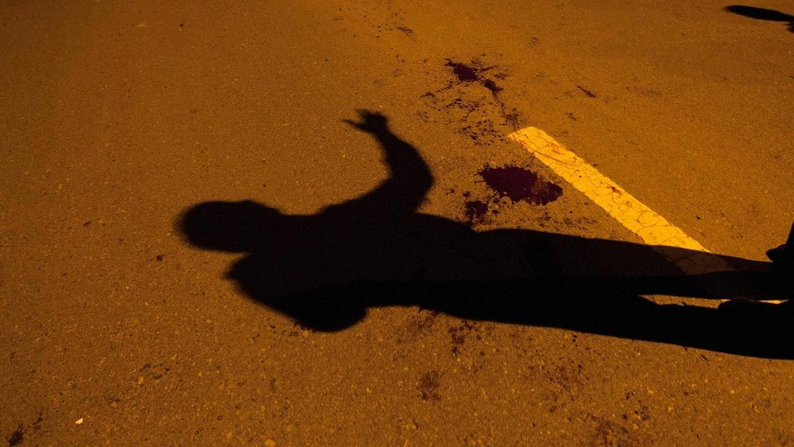 The shadow of a police official is seen near a blood stain after an unidentified gunman was injured by security officials and arrested in Islamabad August 15, 2013. (File photo Reuters)