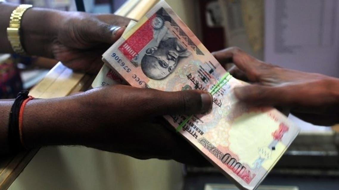 rupees AFP