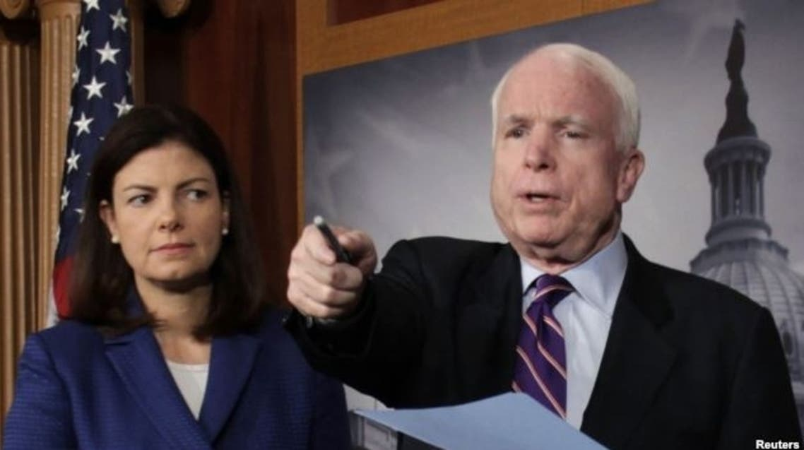 U.S. Republican Senators John McCain (R) and Kelly Ayotte are seen at a news conference on Capitol Hill in Washington, D.C., in this December 21, 2012, file photo.