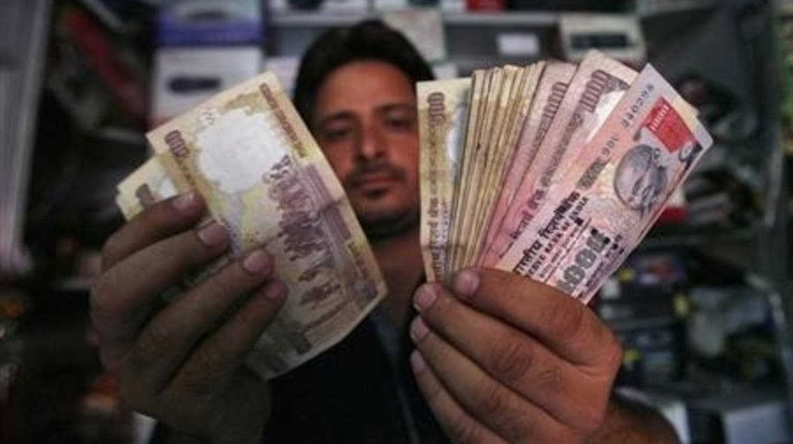 A shopkeeper counts Indian currency notes at his shop in Jammu (File Photo: Reuters)