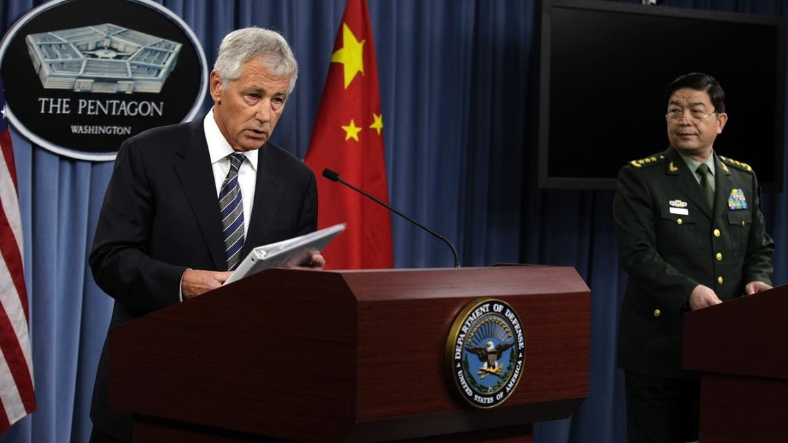U.S. Defense Secretary Chuck Hagel (L) and China's Minister of National Defense General Chang Wanquan speak at a joint news conference following their meeting at the Pentagon in Washington August 19, 2013.