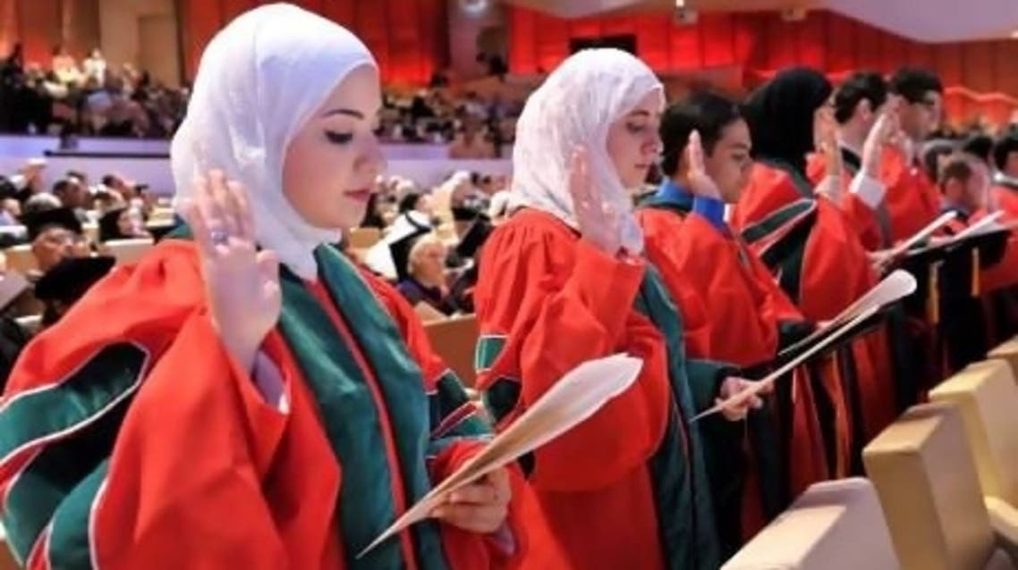 Iqbal Al Assaad (left) receives her medical degree from Cornell University's Qatar branch this year. (Photo courtesy: Weill Cornell Medical College)