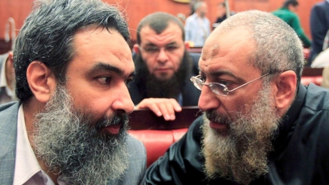 Al-Nour party member Yasser Borhami (R) speaks with Bassam al-Zarqa, one of the advisers to Egypt's President Mohammed Morsi, at the Shura Council during the final vote on a draft new Egyptian Constitution, Nov. 29, 2012. (Reuters)