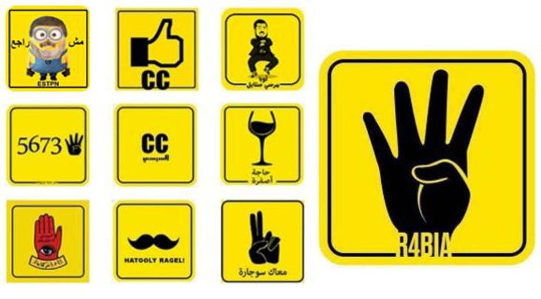 6037d2442579e Four-finger salute  Egypt rivals use  Rabaa hand  to turn Facebook yellow