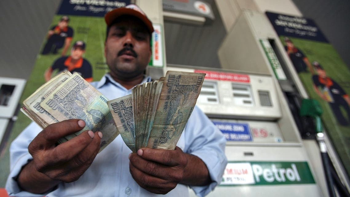man counts indian rupees reuters