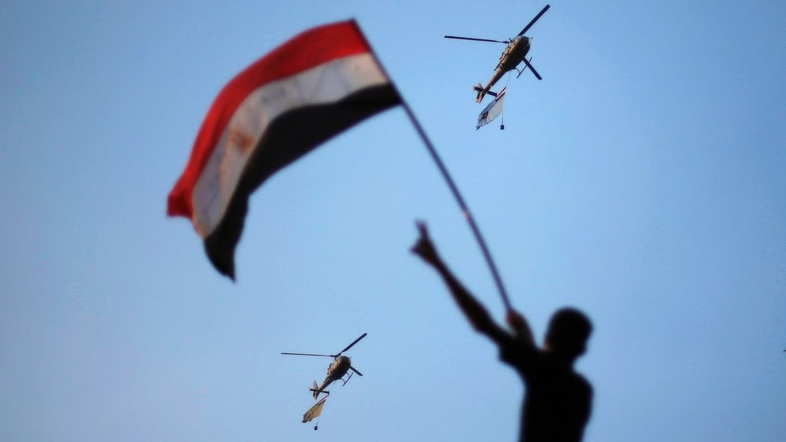Egyptian military helicopters trailing national flags circled over Cairo's Tahrir Square during a protest demanding that Egyptian President Mohammad Mursi resign on July 1. (File photo: Reuters)