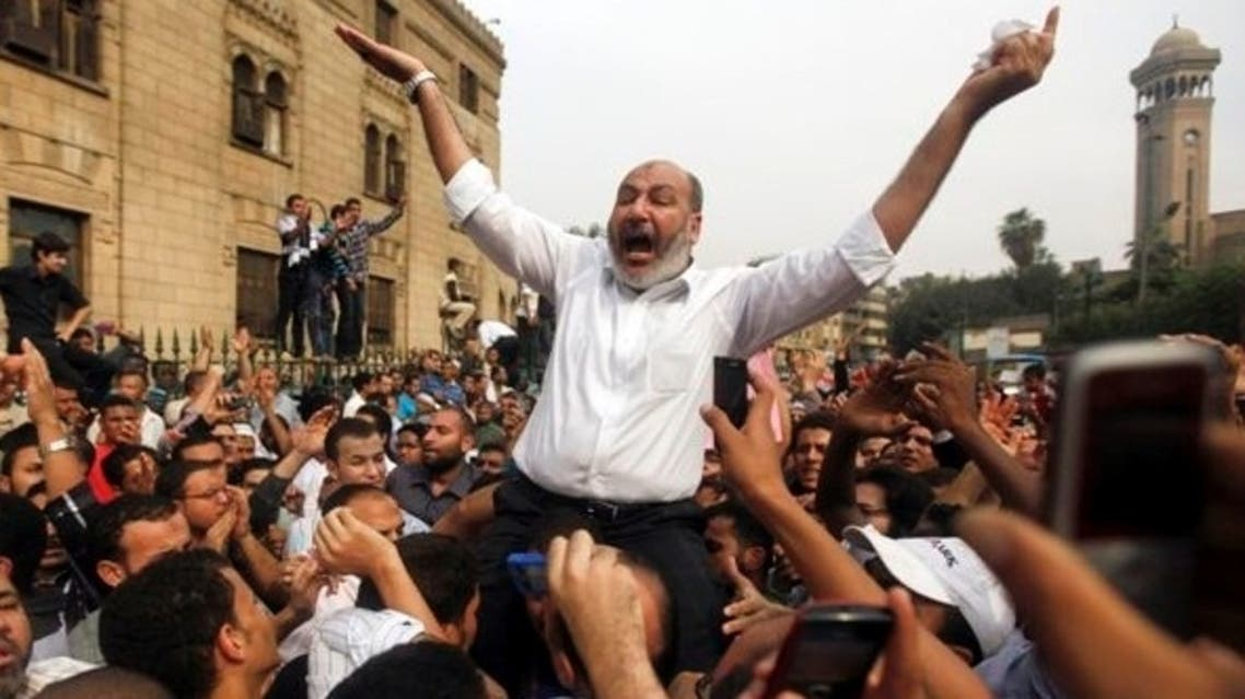 Safwat el-Hegazy (pictured raised above the crowds) told investigators that he was not part of the Muslim Brotherhood, according to security sources. (File photo: Reuters)