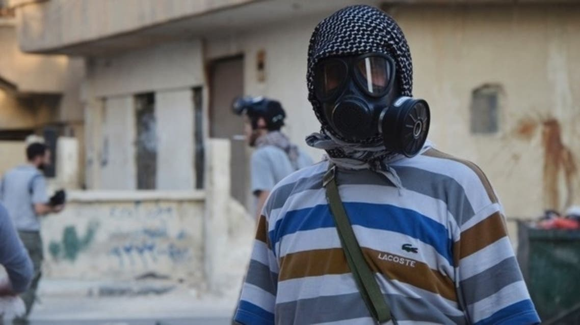 An activist wearing a gas mask is seen in the Zamalka area, where activists say chemical weapons were used by forces loyal to President Bashar Al-Assad in the eastern suburbs of Damascus August 22, 2013. (Reuters)