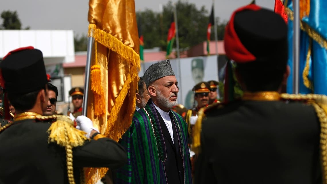 Afghan President Hamid Karzai (C) attends Afghan Independence Day celebrations in Kabul August 19, 2013. reuters