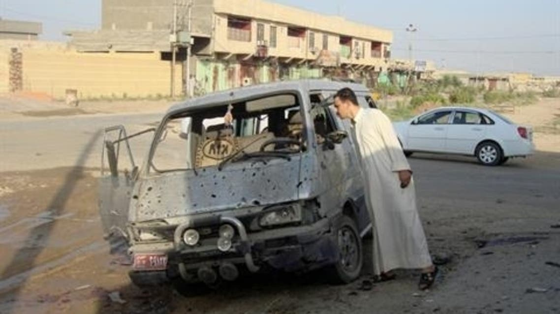 A resident inspects a damaged vehicle a day after a car bomb attack in Dujail, 50 km (31 miles) north of Baghdad, August 23, 2013. (Reuters)