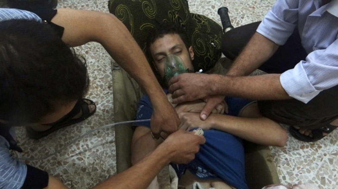 A man, affected by what activists say is nerve gas, breathes through an oxygen mask in the Damascus suburbs of Jesreen. (File Photo: Reuters)