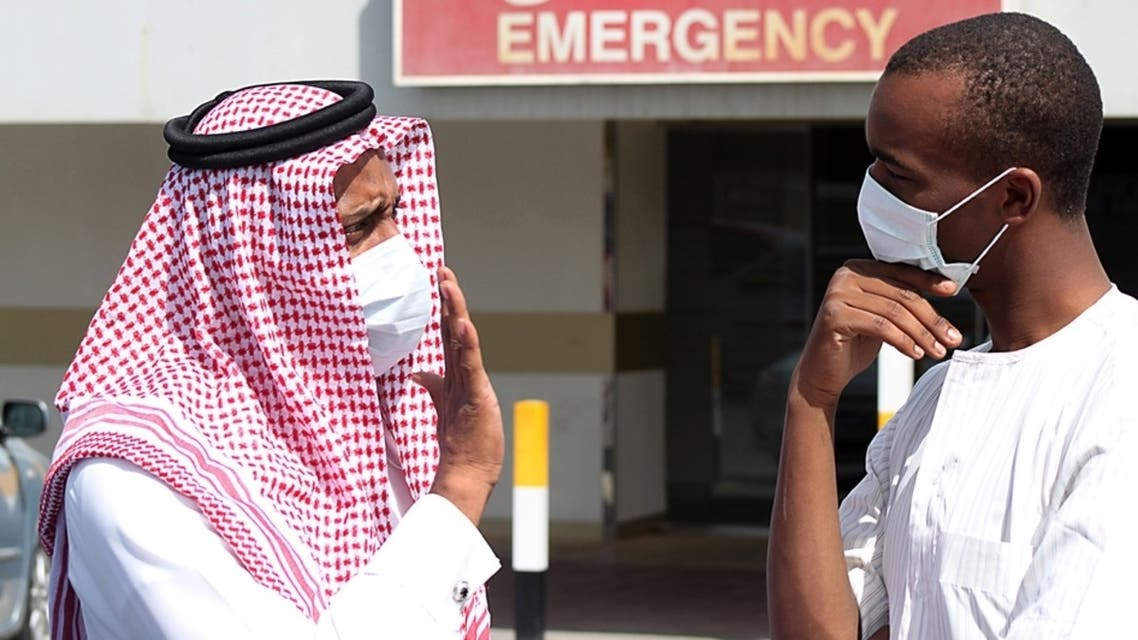 Men outside a hospital in Dammam, Saudi Arabia, wear surgical masks as a precaution against infection. (File Photo: Reuters)