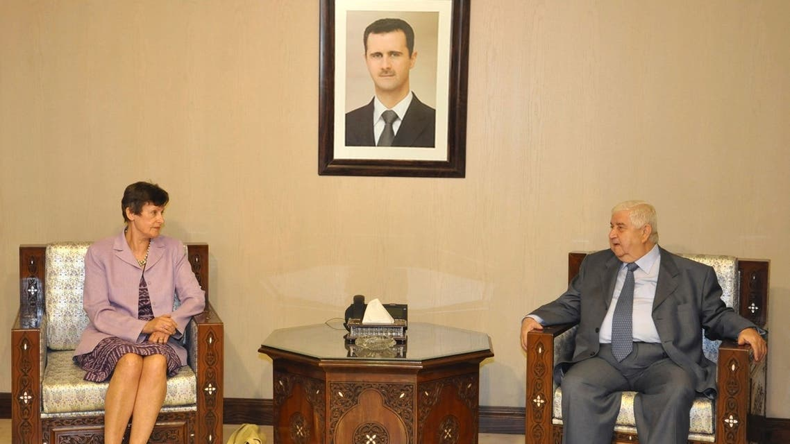 Syrian Foreign Minister Walid al-Muallem (R) meets U.N. High Representative for Disarmament Affairs Angela Kane in Damascus